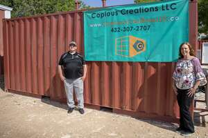 Owners Matt Boden and Angela Wright-Webb of Copious Creation in front of one of their refurbished show storage containers.  Jacy Lewis/191 News