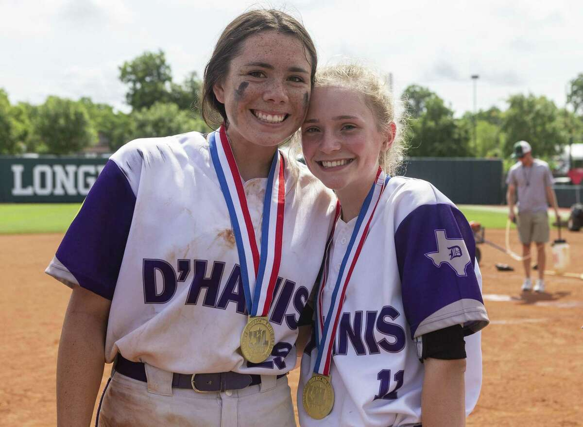 D'Hanis pitcher Marissa Santos (29) and left fielder Addie Harkins (11) pose for a photo with their gold medals after a 9-7 win over Chireno during the UIL Class 1A state softball championship in Austin, Saturday, June 1, 2019.(Stephen Spillman / for Express-News)