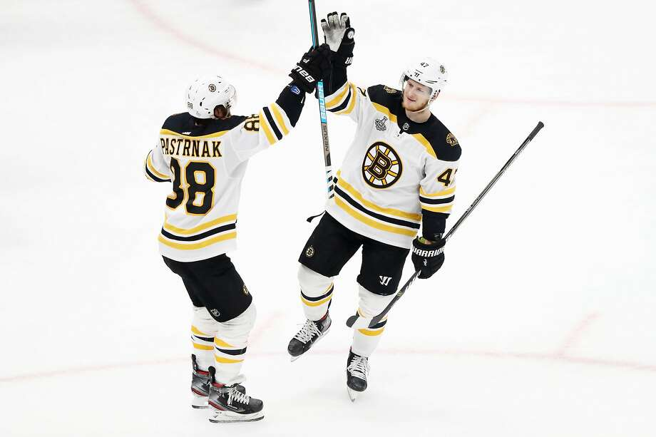 ST LOUIS, MISSOURI - JUNE 01:  Torey Krug #47 of the Boston Bruins is congratulated by his teammate David Pastrnak #88 after scoring a second period goal against the St. Louis Blues in Game Three of the 2019 NHL Stanley Cup Final at Enterprise Center on June 01, 2019 in St Louis, Missouri. (Photo by Jamie Squire/Getty Images) Photo: Jamie Squire, Getty Images
