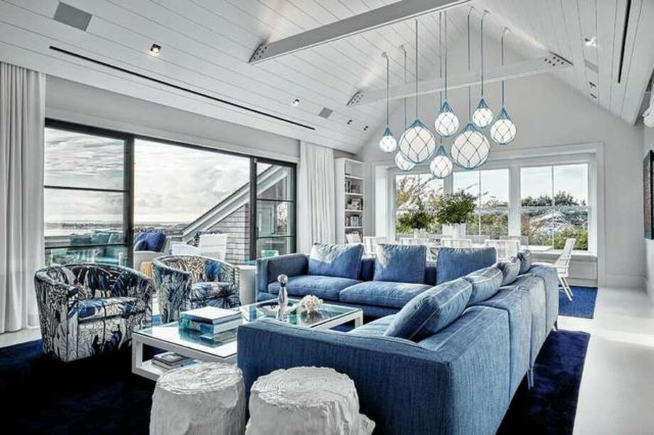 Buoy-style Fisherman pendants from Zero Lighting are wrapped in custom blue cording to reference the seaside location of this Montauk home, designed by Ghislaine Vinas. Crisp whites and blues also reference the beach and water. Photo: Garrett Rowland | Ghislaine Viñas Via AP