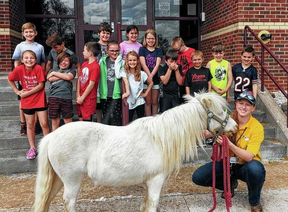 The Pike-Scott Ag in the Classroom program recently visited Griggsville-Perry Elementary to review with students all they had learned in monthly AITC lessons during the school year. Students shared snacks and refreshments and worked together to compete as teams in an Ag Jeopardy game. Students also got to meet Snow White, a miniature horse owned by Judy Douglas. To mark the end of the program's 2018-2019 school year, each teacher who fully participated in the program was given a set of books and educator guides. AITC is funded by the IAA Foundation and the Two Rivers Farm Bureau Foundation, the charitable arm of Pike-Scott Farm Bureau. Photo: Photo Provided