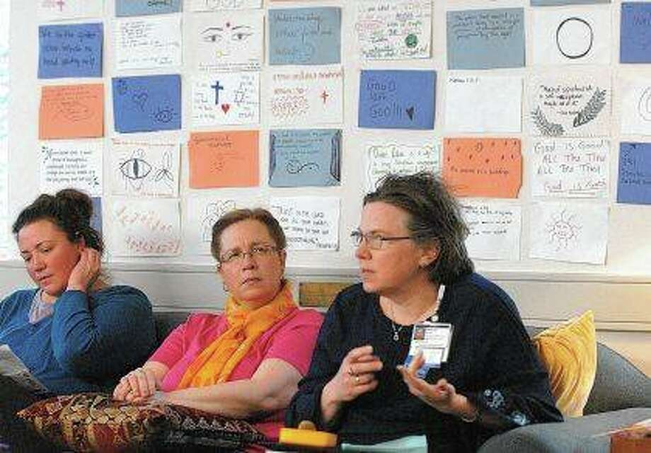 Melanie Dockery (from left) and the Rev. Lynn Shaw listen as the Rev. Mollie Ward, director of Mission & Spiritual Care at Advocate BroMenn Regional Medical Center, brings together ideas that are frequently the subject of meetings at the McLean County Interfaith Alliance during a meeting. Photo: David Proeber | The Pantagraph (AP)