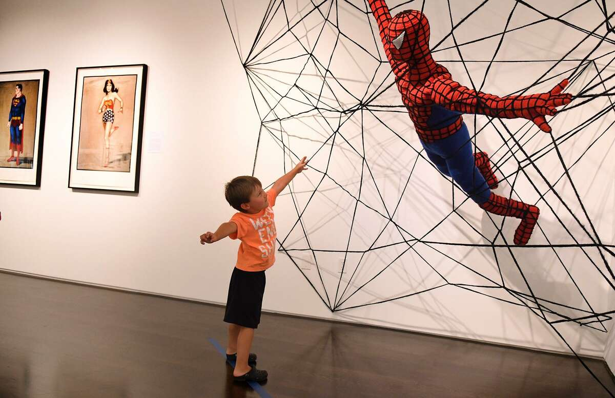 Brailyn Foley, 4, who was with his mom Alicia Abell, of Spring, shows off his best Spiderman pose while the pair were checking out the exhibition at the Pearl Fincher Museum of Fine Art.