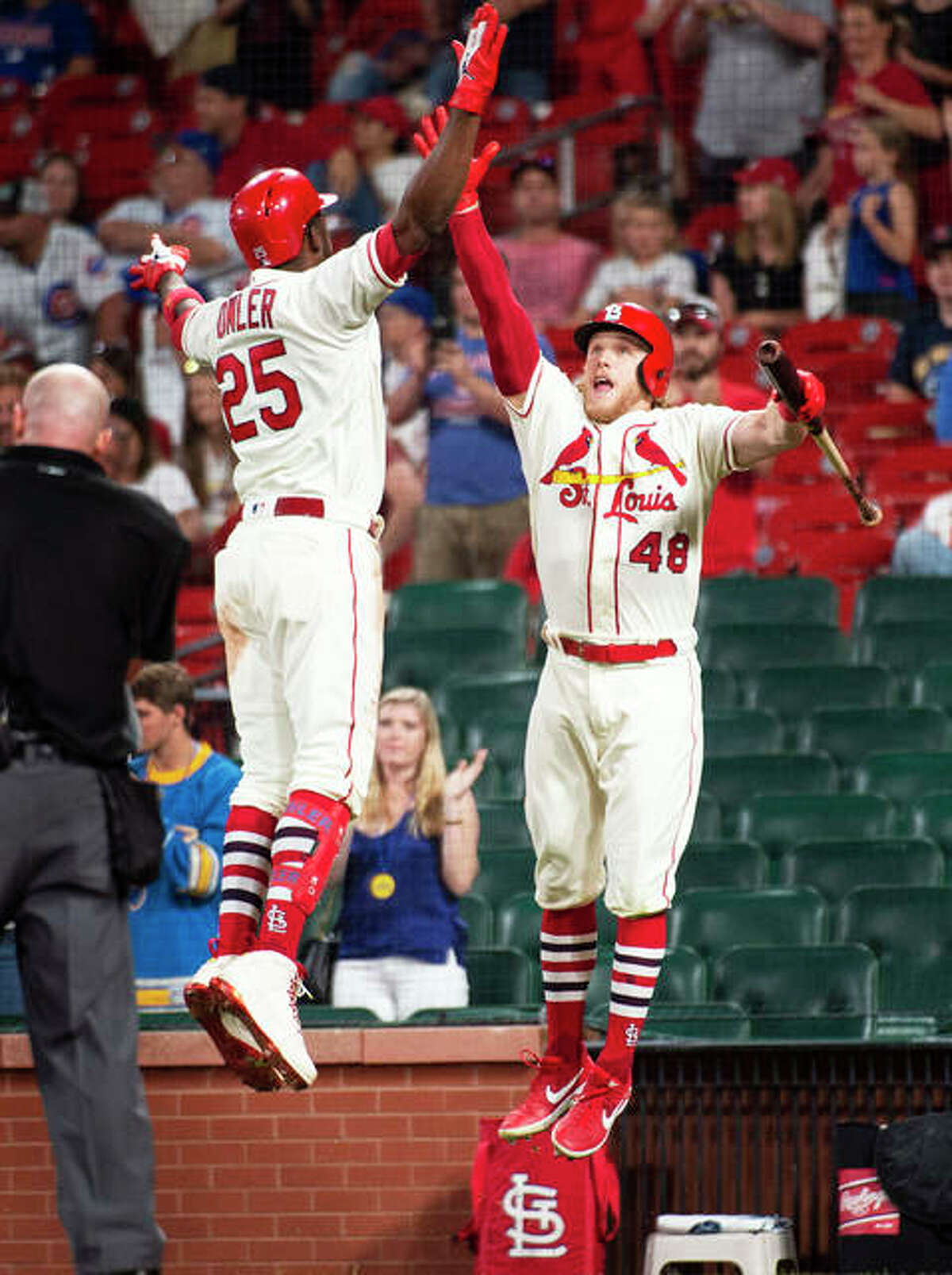 The Cardinals' Dexter Fowler (left) celebrates his home run with teammate Harrison Bader during the eighth inning of against the Cubs after midnight early Sunday at Busch Stadium. Bader then homered to go back-to-back in the Cards' 7-4 rain-delayed victory.
