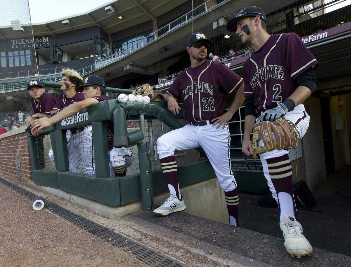 Magnolia West head coach Justin Faltysek talks withDylanVan Wicklenbefore Game 1 of a Region III-5A final series at Blue Bell Park on the campus of Texas A&M University, Thursday, May 30, 2019, in College Station.
