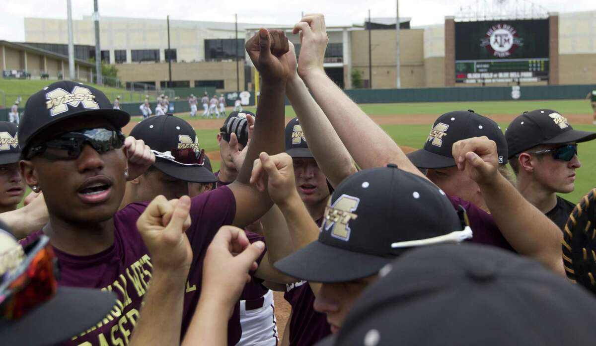 Magnolia West players gather before the first inning of Game 3 during a Region III-5A final series at Blue Bell Park on the campus of Texas A&M University, Saturday, June 1, 2019, in College Station.