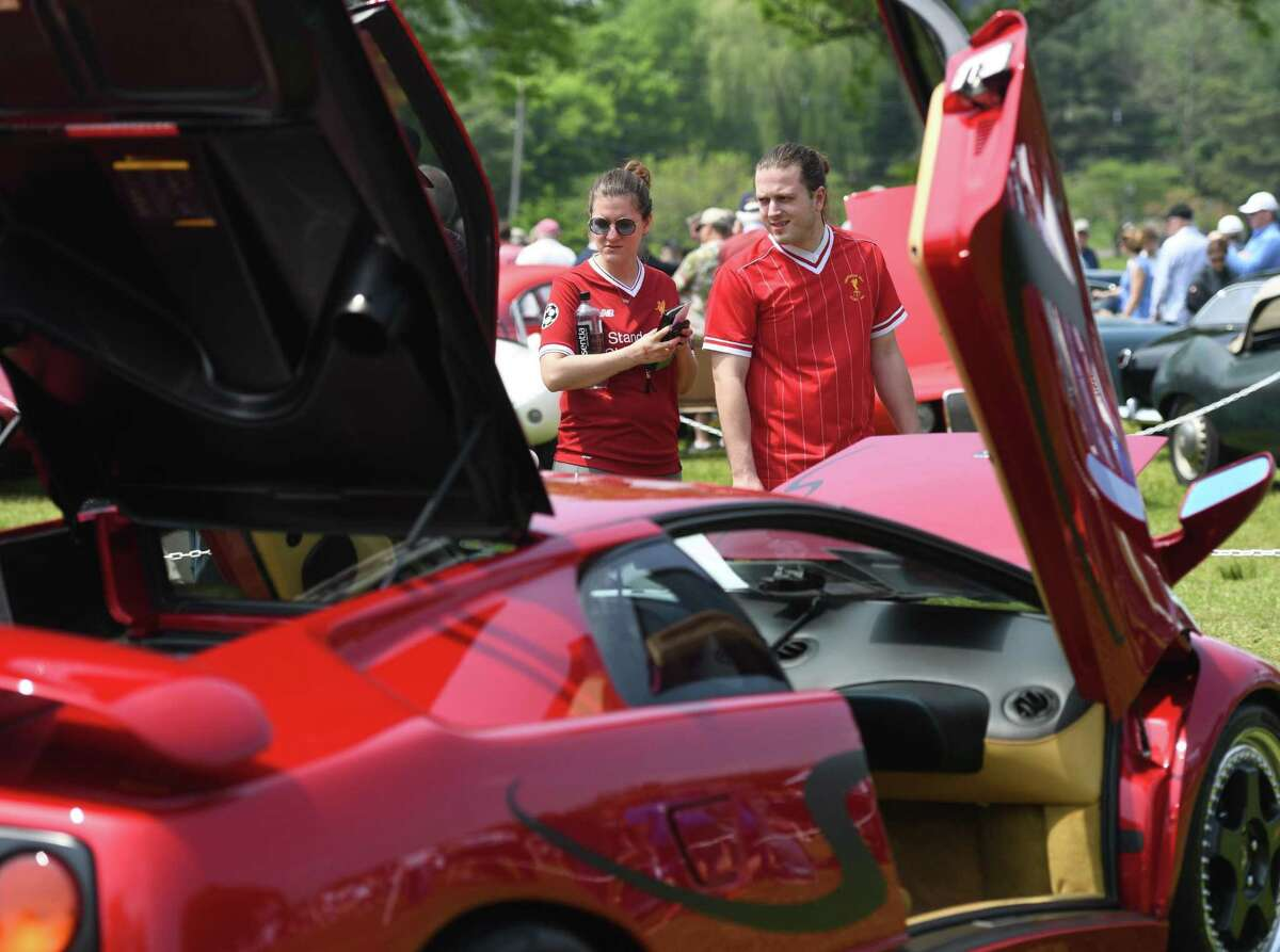 Jackie and Paul Qafa, of White Plains, N.Y., look at a 1998 Lamborghini Diablo Monterey SV Edition at the 24th annual Greenwich Concours d'Elegance at Roger Sherman Baldwin Park in Greenwich, Conn. Sunday, June 2, 2019. The two-day concours is one of the highest-regarded in the country with Saturday being the Concours Americana for American cars and motorcycles and Sunday being the Concours International for imported marques. The Sunday show featured a special Bentley class to commemorate their 100th anniversary.