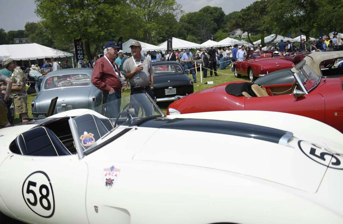 Steve Hawkins, right, who owns the only Arnolt-Bristol in all of Australia, chats with local resident Sam Fader while looking at a 1954 Arnolt-Bristol Competition Roadster at the 24th annual Greenwich Concours d'Elegance at Roger Sherman Baldwin Park in Greenwich, Conn. Sunday, June 2, 2019. The two-day concours is one of the highest-regarded in the country with Saturday being the Concours Americana for American cars and motorcycles and Sunday being the Concours International for imported marques. The Sunday show featured a special Bentley class to commemorate their 100th anniversary.