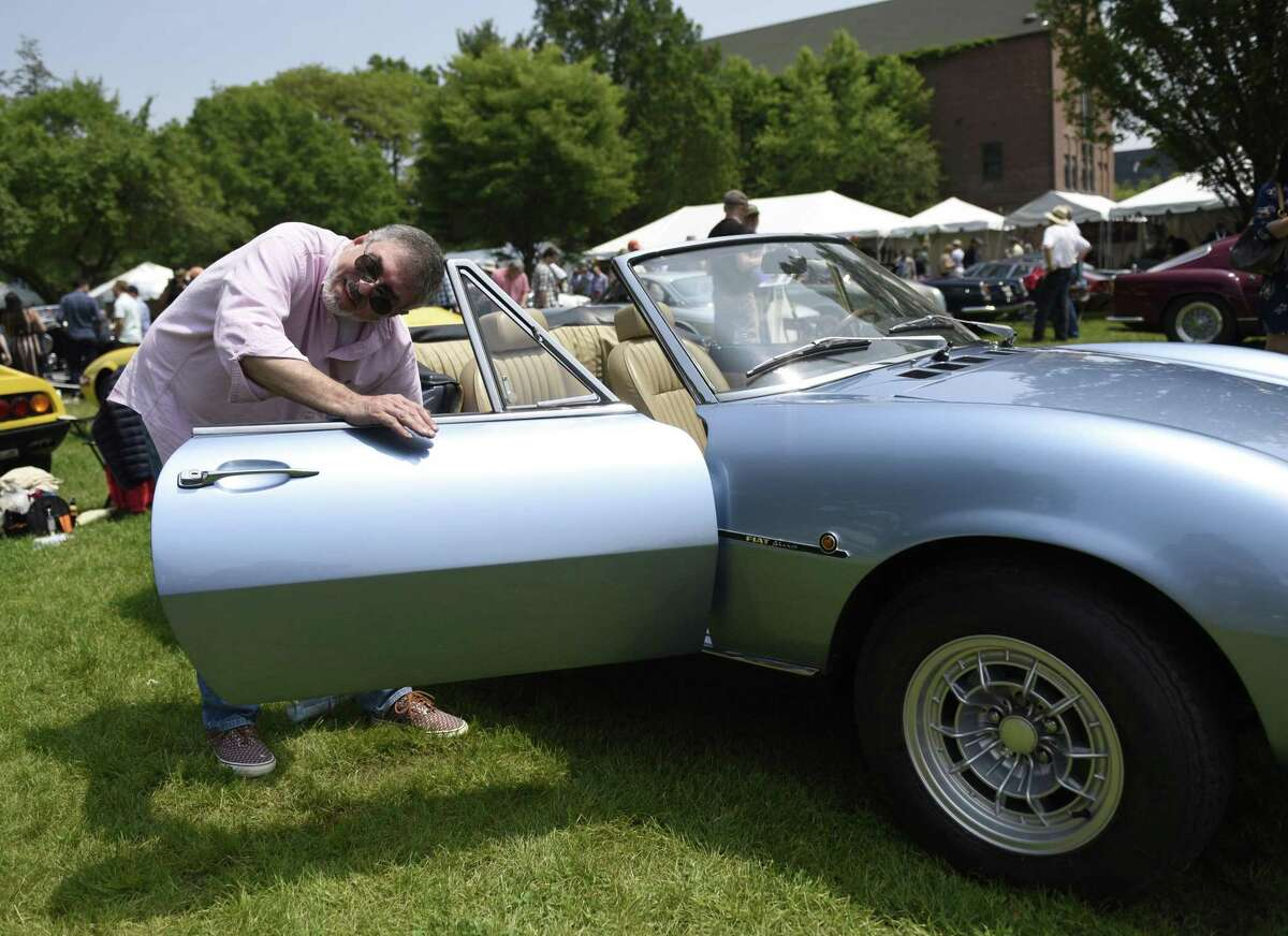 Barry Wagner cleans Jay Goldstein's 1970 Fiat Dino Spider 2400 at the 24th annual Greenwich Concours d'Elegance at Roger Sherman Baldwin Park in Greenwich, Conn. Sunday, June 2, 2019. The two-day concours is one of the highest-regarded in the country with Saturday being the Concours Americana for American cars and motorcycles and Sunday being the Concours International for imported marques. The Sunday show featured a special Bentley class to commemorate their 100th anniversary.