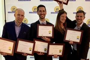 The Fore Group, the company Fotis Dulos owns, earned eight awards from the Home Builders Association of Connecticut in 2018. Fotis Dulos is on the right, with Michelle Troconis.