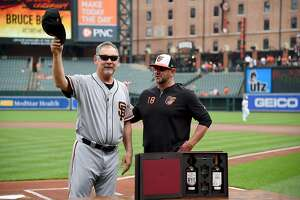 BALTIMORE, MD - JUNE 02: Manager Bruce Bochy #15 of the San Francisco Giants is honored prior to the game with manager Brandon Hyde #18 of the Baltimore Orioles at Oriole Park at Camden Yards on June 2, 2019 in Baltimore, Maryland. (Photo by Will Newton/Getty Images)