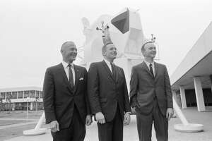 Apollo 11 astronauts Buzz Aldrin, Neil Armstrong and Michael Collins photographed in front of a lunar module (LM) mock-up beside Building 1 following a press conference in the MSC Auditorium Jan. 10, 1969.