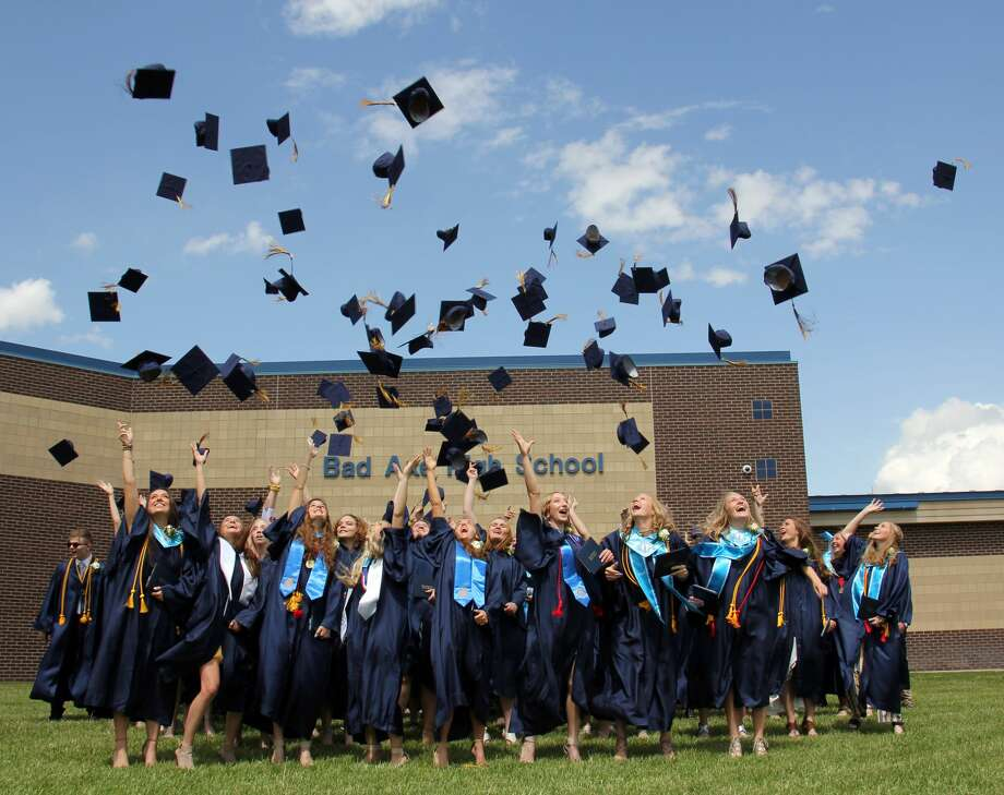Bad Axe High seniors crossed the finish line of their high school careers Sunday afternoon with as the one-by-one received their diplomas. Photo: Bradley Massman/Huron Daily Tribune
