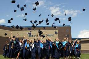 Bad Axe High seniors crossed the finish line of their high school careers Sunday afternoon with as the one-by-one received their diplomas.
