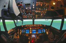 Boeing 737-800 cockpit simulator with Flight Dynamics head-up display HUD. (Photo by: aviation-images.com/UIG via Getty Images)