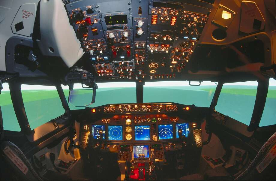 "FILE-- Boeing 737-800 cockpit simulator with Flight Dynamics head-up display HUD. According to Apex, Boeing is working on a new, virtual cabin assistant concept called ""Ellen,"" which would help assist cabin crews by automating tasks, so crews can focus on passenger needs. Photo: Aviation-images.com/UIG Via Getty Images"