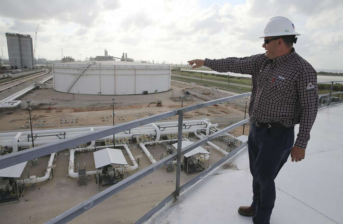 NuStar Energy Director of Operations for Central West South Chris Vratil points out the construction for a new pipeline at NuStar's 400-series tank farm in Corpus Christi on Tuesday, May 28, 2019.
