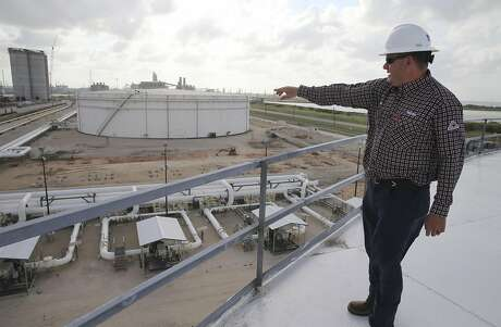 NuStar Energy Director of Operations for Central West South Chris Vratil points out the construction for a new pipeline at NuStar's 400-series tank farm in Corpus Christi on Tuesday, May 28, 2019. Corpus Christi is becoming a major port for the export of oil from the Permain Basin and The Eagle Ford. One of the big players is NuStar Energy which operates four docks along the  Corpus Christi industrial canal. Like many energy storage companies, NuStar is looking forward to the completion of several projects at the canal such as the new Harbor Bridge project which will allow for bigger vessels to pass into the canal and thus can take on more barrels of oil for shipment and a new and larger pipeline which will feed into NuStar's 400-series tank farm. Projects that the new bridge and new pipelines are cementing Corpus Christi as an emerging port of commerce in the energy sector. (Kin Man Hui/San Antonio Express-News)