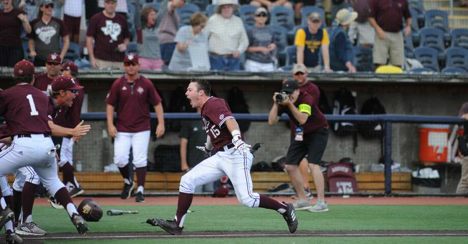 Bryce Blaum and the Texas A&M Aggies celebrate after eliminating host West Virginia 11-10 on Sunday with a walkoff grand slam. Photo: Kaitlyn Cole