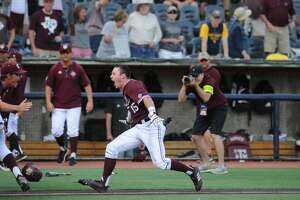 Bryce Blaum and the Texas A&M Aggies celebrate after eliminating host West Virginia 11-10 on Sunday with a walkoff grand slam.