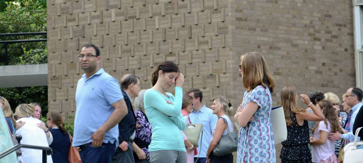 Members of the community gathered for a vigil at St. Mark's Episcopal Church in New Canaan on Sunday to pray for Jennifer Dulos, a mother of five, who has been missing for more than one week.