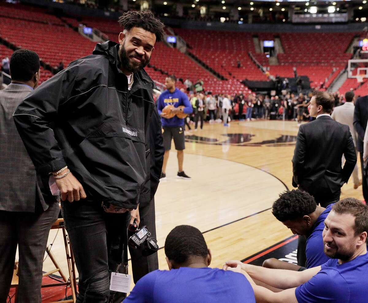 JaVale McGee pays a visit to his former teammates on the bench during warmups before the Golden State Warriors played the Toronto Raptors practiced in Game 2 of the 2019 NBA Finals at Scotiabank Arena in Toronto, Ontario, Canada, on Sunday, June 2, 2019. The Raptors lead the series 1-0.
