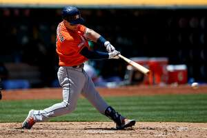 OAKLAND, CA - JUNE 02:  Alex Bregman #2 of the Houston Astros hits an RBI single against the Oakland Athletics during the fifth inning at the Oakland Coliseum on June 2, 2019 in Oakland, California. (Photo by Jason O. Watson/Getty Images)
