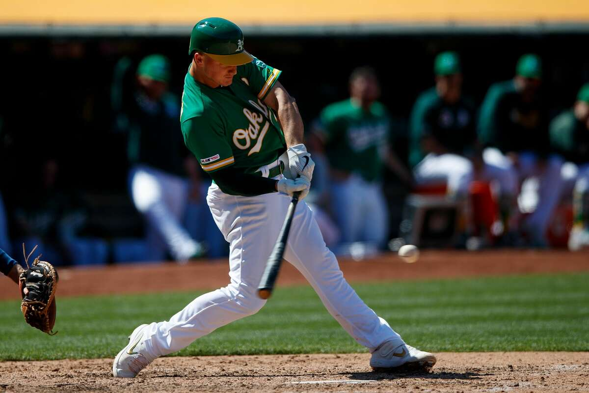 OAKLAND, CA - JUNE 02: Matt Chapman #26 of the Oakland Athletics hits a home run against the Houston Astros during the eighth inning at the Oakland Coliseum on June 2, 2019 in Oakland, California. (Photo by Jason O. Watson/Getty Images)