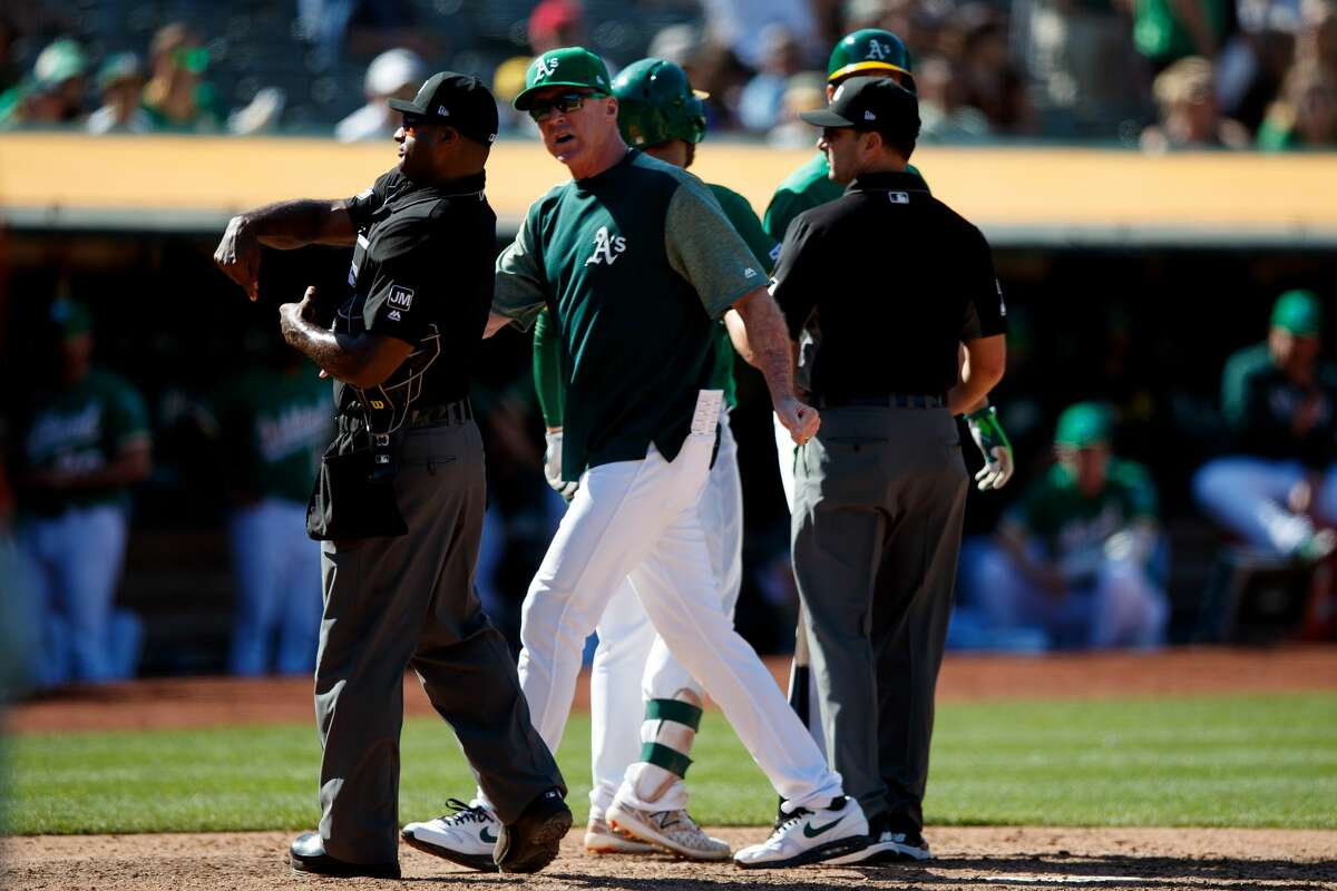 OAKLAND, CA - JUNE 02: Bob Melvin #6 of the Oakland Athletics is ejected by umpire Alan Porter #64 after arguing a called third strike on Stephen Piscotty (not pictured) during the tenth inning against the Houston Astros at the Oakland Coliseum on June 2, 2019 in Oakland, California. (Photo by Jason O. Watson/Getty Images)