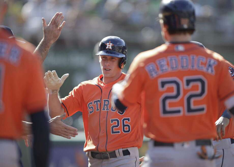 Houston Astros' Myles Straw (26) celebrates after scoring against the Oakland Athletics in the 12th inning of a baseball game Sunday, June 2, 2019, in Oakland, Calif. (AP Photo/Ben Margot) Photo: Ben Margot, STF / Associated Press / Copyright 2019 The Associated Press. All rights reserved.