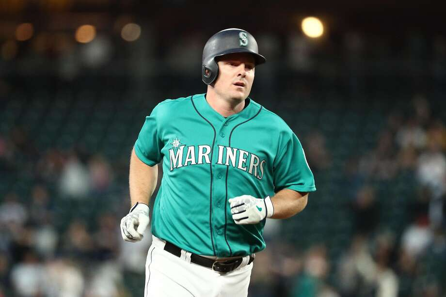 SEATTLE, WASHINGTON - MAY 31: Jay Bruce #32 of the Seattle Mariners laps the bases after hitting his 300th career home run against the Los Angeles Angels of Anaheim in the seventh inning during their game at T-Mobile Park on May 31, 2019 in Seattle, Washington. (Photo by Abbie Parr/Getty Images) Photo: Abbie Parr, Getty Images