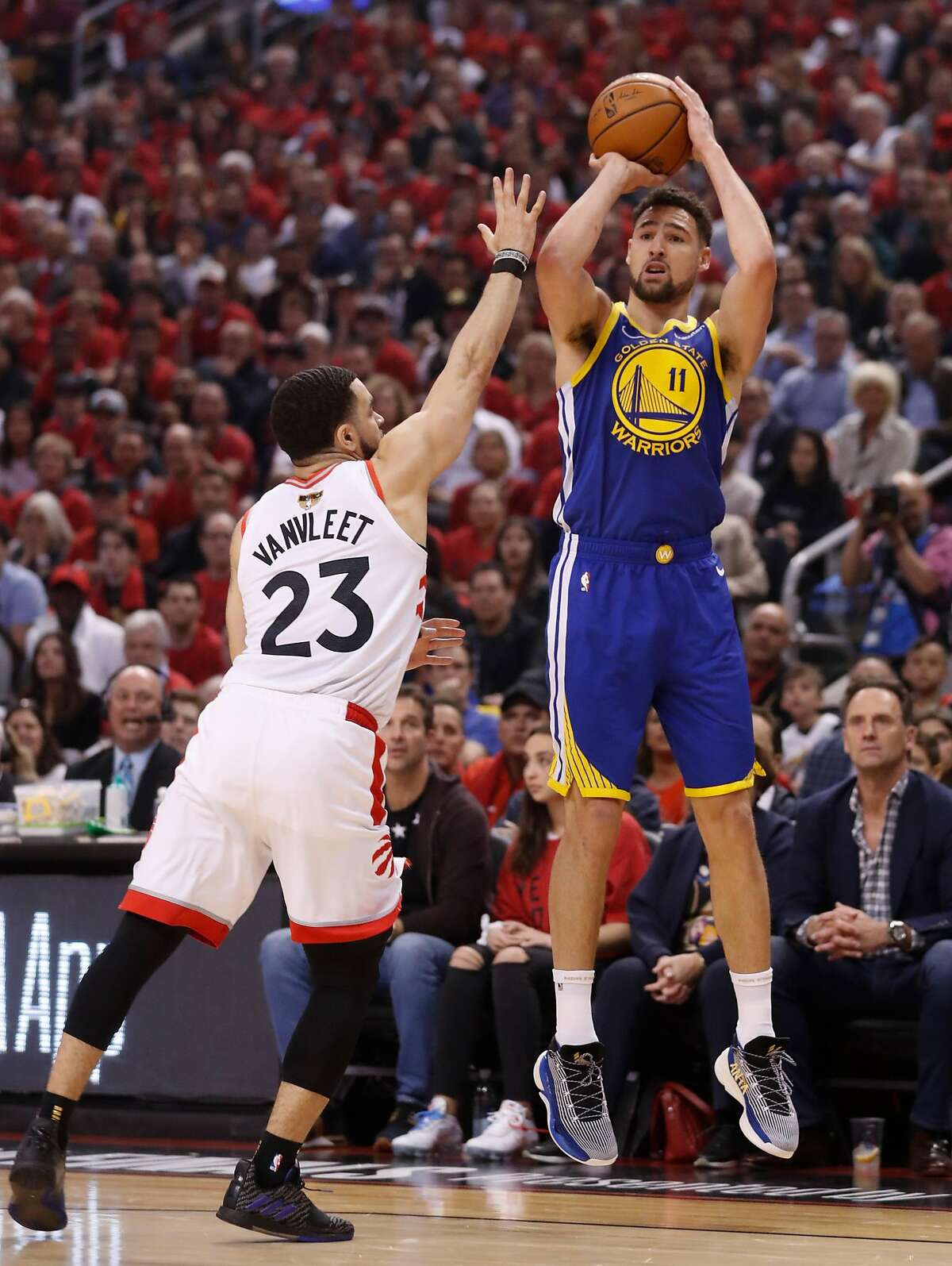 Golden State Warriors' Klay Thompson shoots over Toronto Raptors' Fred VanVleet in the first quarter during game 2 of the NBA Finals between the Golden State Warriors and the Toronto Raptors at Scotiabank Arena on Sunday, June 2, 2019 in Toronto, Ontario, Canada.
