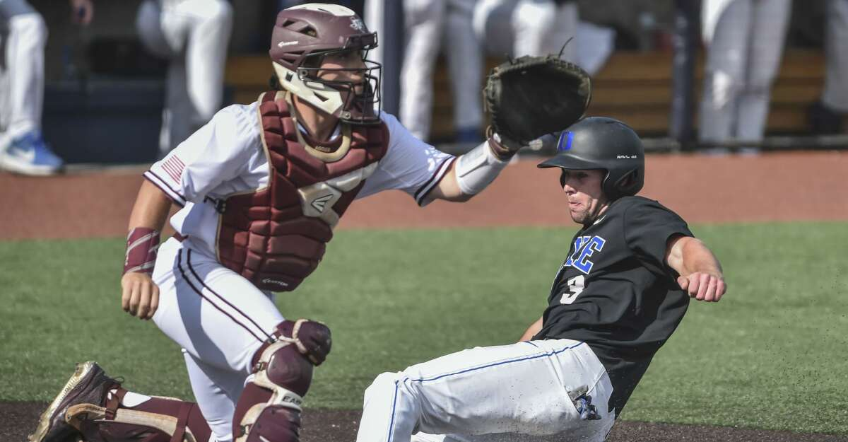 Duke's Chris Crabtree (3) beats the tag by Texas A&M's Mikey Hoehner (44) during an NCAA college baseball tournament regional game Friday, May 31, 2019, in Morgantown, W.Va. (William Wotring/The Dominion-Post via AP)