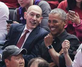 NBA Commissioner Adam Silver and President Barack Obama talk during the first quarter during game 2 of the NBA Finals between the Golden State Warriors and the Toronto Raptors at Scotiabank Arena on Sunday, June 2, 2019 in Toronto, Ontario, Canada.