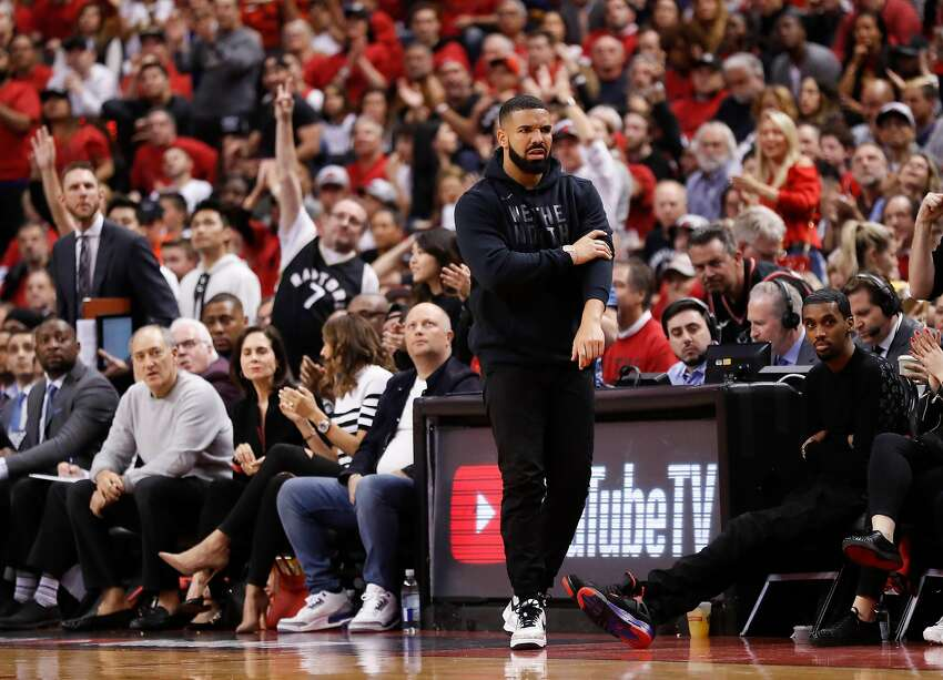Drake walks on the side of the court in the third quarter during game 2 of the NBA Finals between the Golden State Warriors and the Toronto Raptors at Scotiabank Arena on Sunday, June 2, 2019 in Toronto, Ontario, Canada.