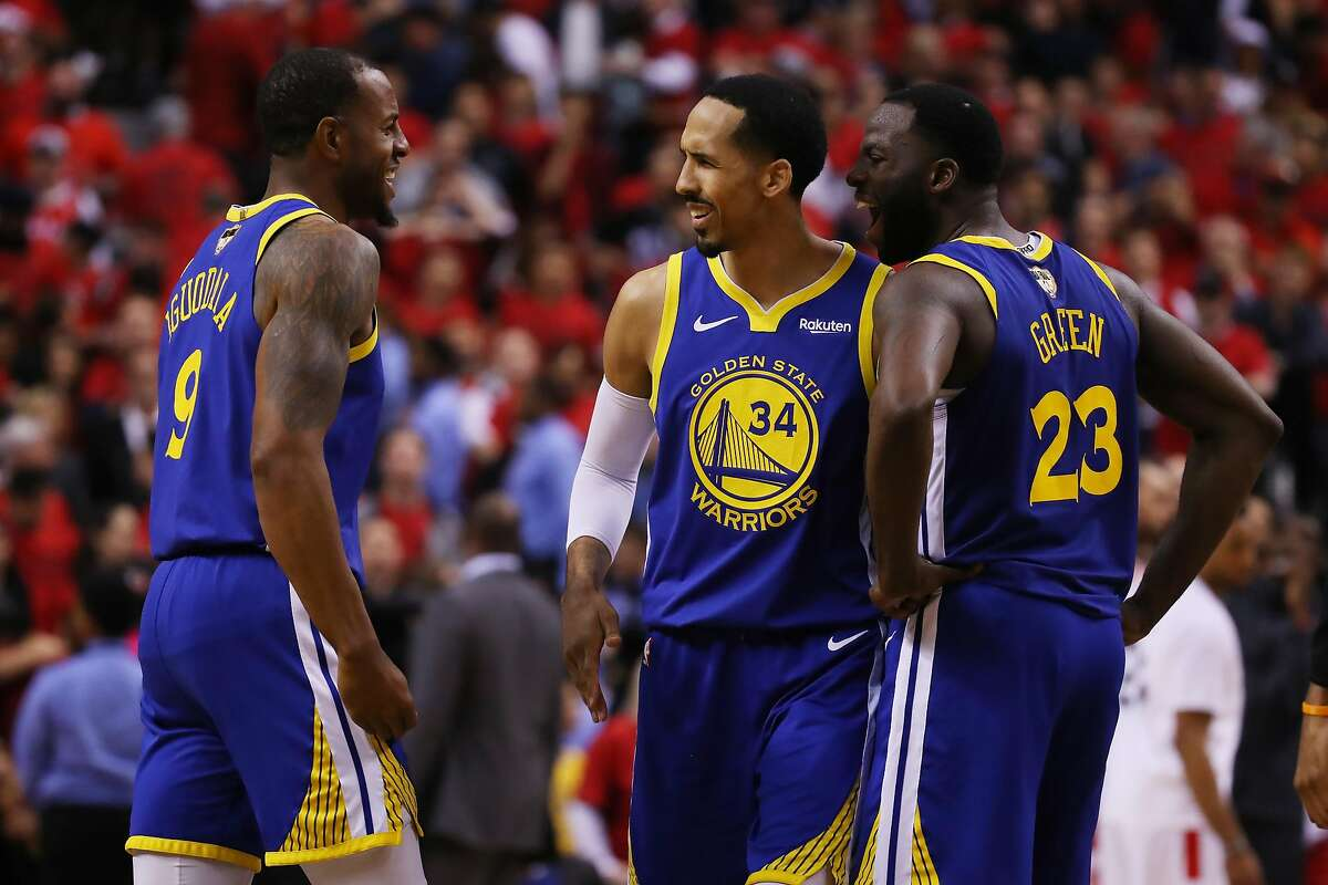 FILE - Andre Iguodala #9 is congratulated by his teammates Shaun Livingston #34 and Draymond Green #23 of the Golden State Warriors after scoring a basket against the Toronto Raptors in the second half during Game Two of the 2019 NBA Finals at Scotiabank Arena on June 02, 2019 in Toronto, Canada.