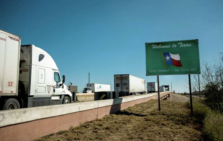"FILE -- Trucks enter Laredo, Texas, after crossing from Nuevo Laredo, Mexico, Jan. 12, 2019. President Trump said Thursday, May 30, 2019, that he would impose a 5 percent tariff on all imported goods from Mexico beginning June 10, a tax that would ""gradually increase"" until the flow of undocumented immigrants across the border stopped. (Meredith Kohut/The New York Times) Photo: MEREDITH KOHUT, STR / NYT / NYTNS"