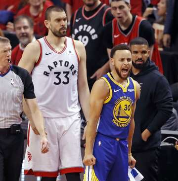 4d30c5044d2 1of5Golden State Warriors' Stephen Curry reacts to Quinn Cook's 3-pointer  during 109-104 win over Toronto Raptors in NBA Finals' Game 2 at ScotiaBank  Arena ...