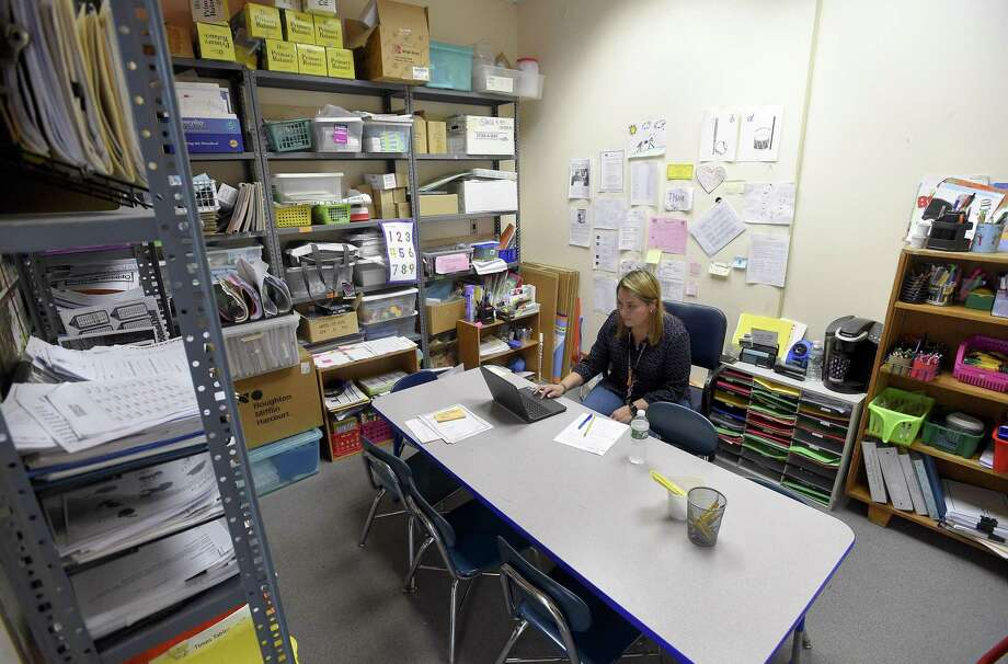 Newfield Elementary special education teacher Lissette Rhazali works in her makeshift classroom on May 10, 2019 that is set up in a supply closet at the school. The school had to vacate six of its portable classrooms in October 2018, due to issues with mold. These classrooms are not set to be replaced, resulting in the crowding of a classroom into makeshift spaces in the main building. Photo: Matthew Brown / Hearst Connecticut Media / Stamford Advocate