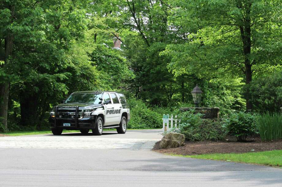 A Farmington police cruiser leaves the private road leading to Fotis Dulos' home, which has been the target of a search warrant in the disppearance of his estranged wife, Jennifer Dulos. Photo: Dan Haar / Hearst Connecticut Media