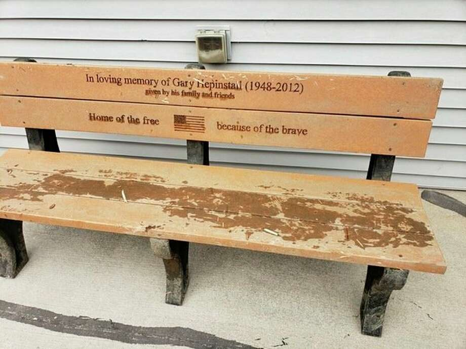 The memorial bench for Gary Hepinstall was dirty with grime after being pulled out of the Saginaw River. (Photo provided/Dave Schwab)