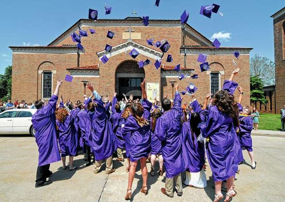 Graduates keep tradition alive by tossing their caps into the air at the end of the Routt Catholic High School graduation on Sunday. Photo: David Blanchetee | For The Journal-Courier