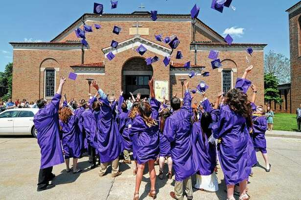 Graduates keep tradition alive by tossing their caps into the air at the end of the Routt Catholic High School graduation on Sunday.