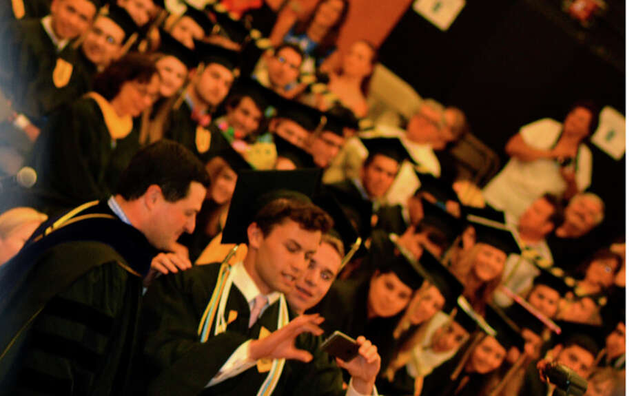 Class President Fred Tamarkin gets ready to take a selfie with First Selectman Tim Herbst. —Lisa Romanchick photo
