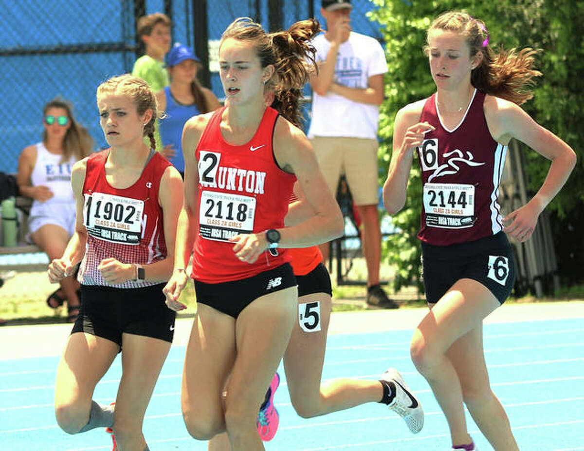 """Staunton's Lydia Roller (middle) leads the pack early in the 3,200 meters at the Class 2A girls track state finals on May 18 at Eastern Illinois University in Charleston. Roller capped her sophomore prep season with a fourth-place finish in the 3,200 and a second-place run in the 1,600 at state with a time of 5:11.80. Roller's next competitive event came Thursday at the Festival of Miles with an invitation-only field for the 1,600 meters at Saint Louis U High. Roller left the state meet at Charleston with hopes of running a sub-five minutes - """"that's my only goal,"""" she said - at the Festival of Miles and she did that for the first time in her career. Roller ran the 1,600 in 4 minutes, 59.60 seconds to place 10th in an elite field of 16 high school girls distance runners that had 10 break five minutes. Samantha Schadler, a Duke recruit and Arizona state champion from Rio Rico High School, won in 4:48.33. Edwardsville's Abby Korak was 14th in 5:02.47 after placing eighth in the Class 3A state meet in 5:05.46 in Charleston."""