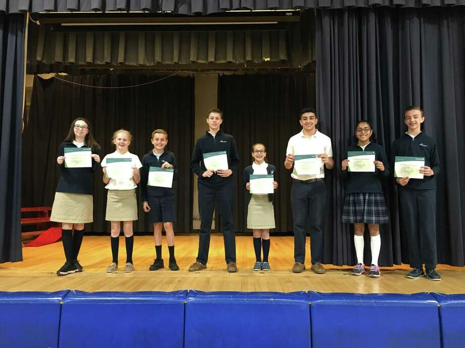 From left to right: Lauren Goodman, Cami O'Rourke, Colin Hoyt, Shaun McKenna, Faith Bargellini, Avedis Ovanessian, Sania Toprani and Alex Godino. The students from St. Joseph's Academy in Brookfield earned awards during a speech contest sponsored by Modern Woodmen of America. Photo: Contributed Photo / Contributed / The News-Times Contributed