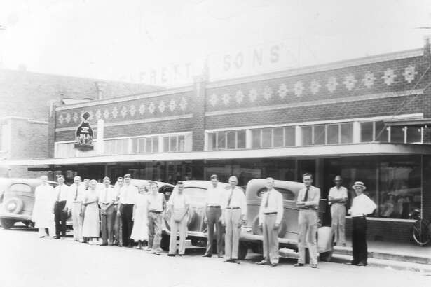 The employees of Everett and Sons outside the store on Simonton Street in downtown Conroe.