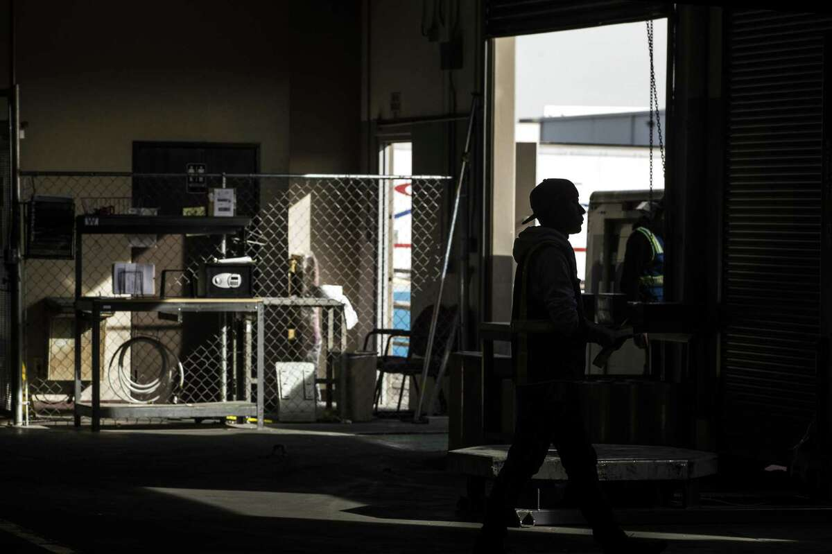 Employees work in a the transportation and logistics company's warehouse on Thursday, Feb. 1, 2018, in El Paso, Texas. Companies across Texas could be among the hardest hit in the country by tariffs on Mexican goods due to the highly integrated supply chains with Mexico relative to other areas of the U.S.