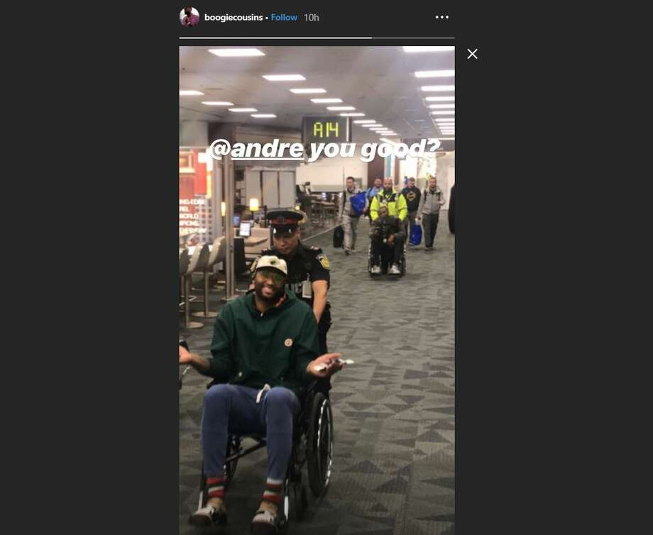 DeMarcus Cousins posted this image of himself and teammate Andre Iguodala getting wheeled to the plane at the Toronto Airport. Photo: DeMarcus Cousins