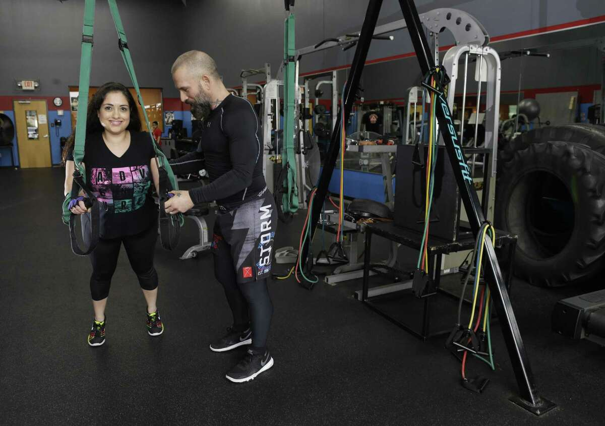 Eve Garcia works out with trainer Paul Moran at Gracie Barra Katy Mixed Martial Arts in Katy.